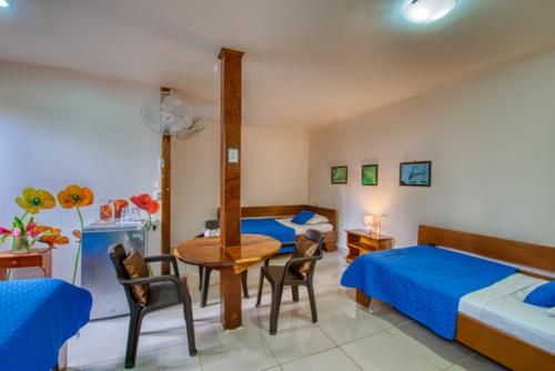 Cabinas-Yucca-Beachfront-Zimmer-Drei-Personen-Zimmer-Gartenseite