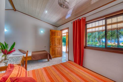 Cabinas-Yucca-Beachfront-Zimmer-Drei-Personen-Zimmer-Strandseite