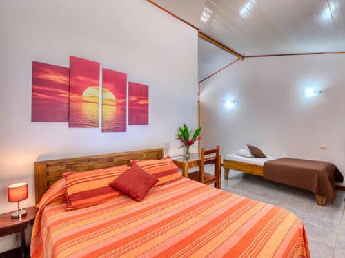 Zimmer-beds-Triple-Standard-Beachfront-Fan-Terrace